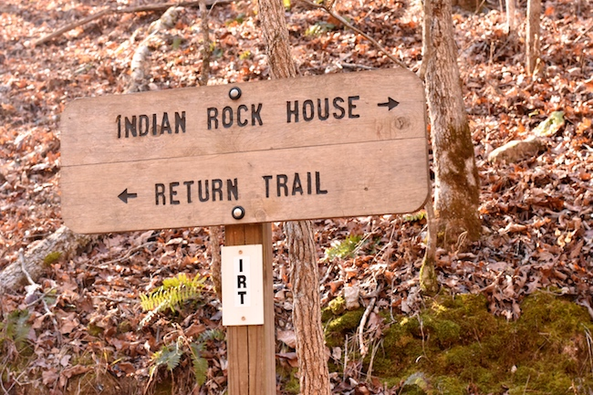 Trail signage along the Indian Rockhouse trail