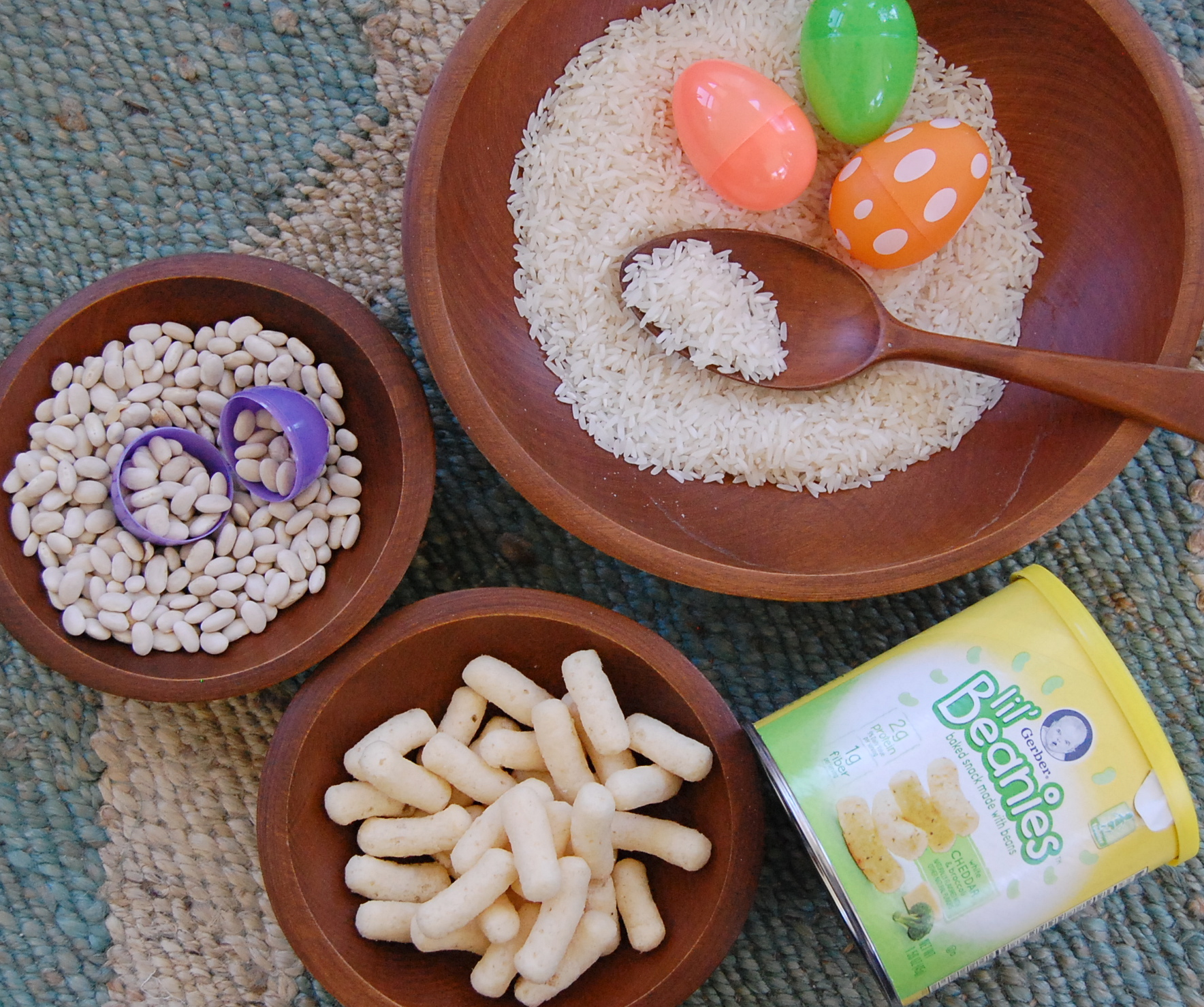 A fun toddler sensory experience using items from your pantry and leftover Easter eggs! #gerberlilbeanies #sensoryplay #toddlerplay #toddler snacks juliannegray.com